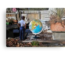 After leaving his earth sculpture in the garden overnight, Wes finds undisputed evidence of global worming. Metal Print