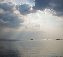 Sunrays scattered by clouds over Trieste Bay by Ian Middleton