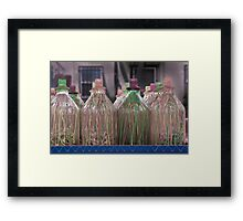 Colorful Wax Dripped over Bottles as Part of a Carnival Game Framed Print