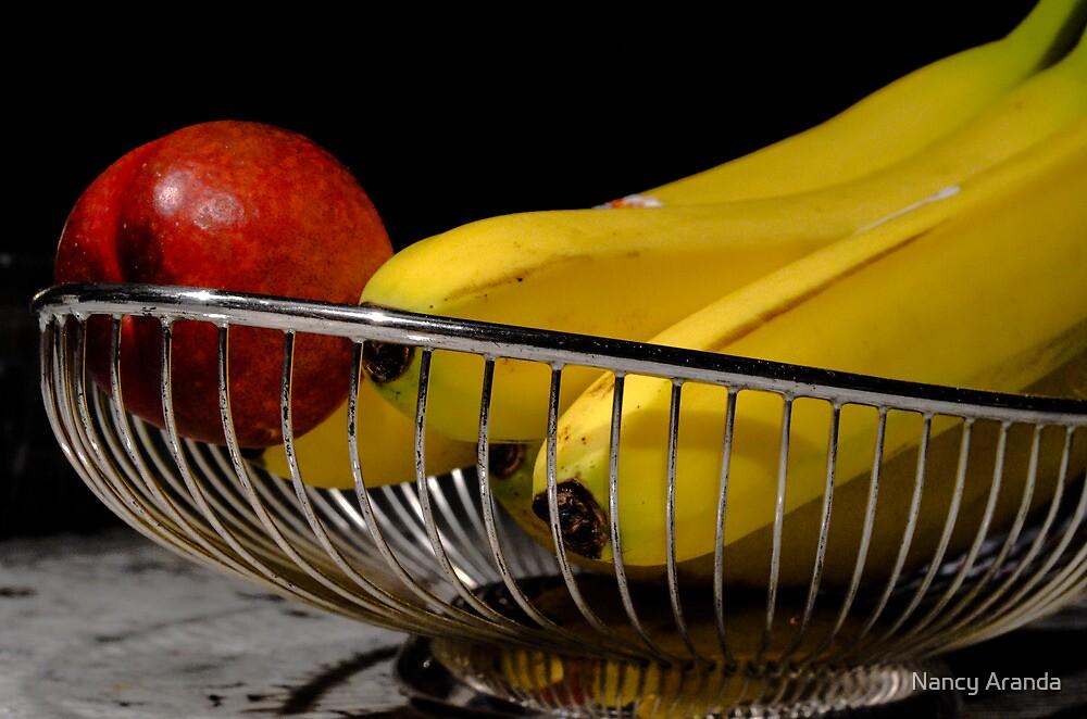 fruit in a cage by Nancy Aranda