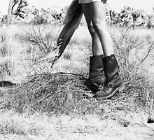 Girl's Legs Wearing Boots in the Desert by laurenelisabeth