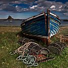 Moody Skies over Lindisfarne by Phillip Dove