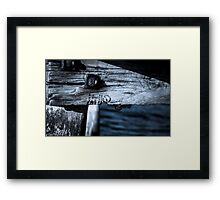 Holding back the waves Framed Print