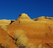 Orange hills and blue sky by Claudio Del Luongo