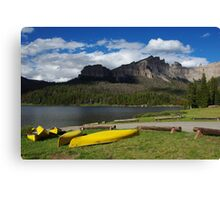 Yellow canoes and Brooks Lake, Wyoming Canvas Print