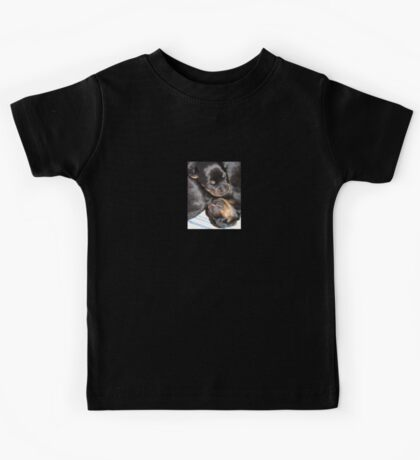 A Beautiful Dreamer In A Litter of  Rottweiler Puppies Kids Tee