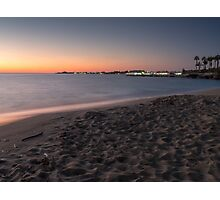 Sunset on a beach shore  Photographic Print