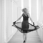 Beautiful woman wearing running down a corridor by DeborahKolb