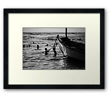 silhouettes in water Framed Print
