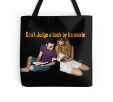 Don't judge a book by its movie. Tote Bag