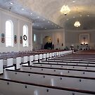 Sea of Pews at Christmas by Gene Walls