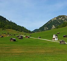 Beautiful mountain huts with small church by Claudio Del Luongo