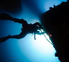 underwater Commercial diver welding pipes underwater. by PhotoStock-Isra