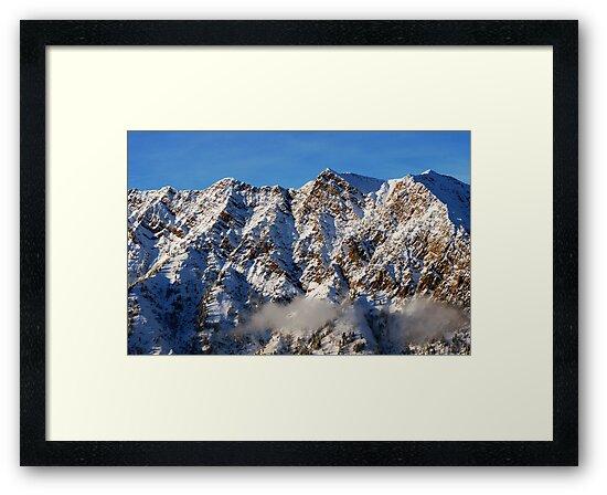 Sunset at mountains from summit of Snowbird ski resort in Utah by Anton Oparin
