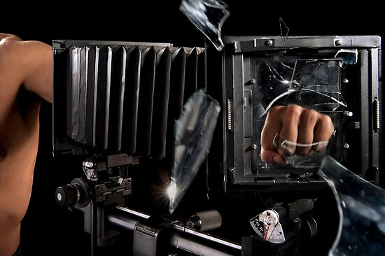 Fist smashes glass  by PhotoStock-Isra