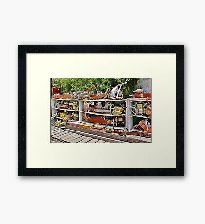 The Wall of Old Chainsaws Framed Print