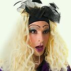 excited Drag Queen with blond wig by PhotoStock-Isra