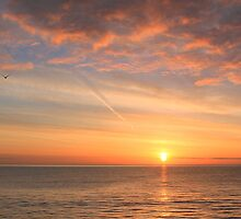 classic sunrise over the sea by geoffford