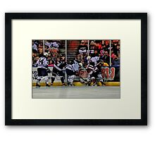 Scramble For The Puck Framed Print