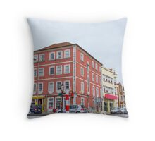 The pink building Throw Pillow