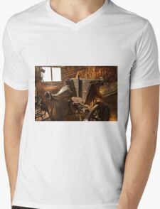 Old style agricultural tools in a wooden shed. Mens V-Neck T-Shirt