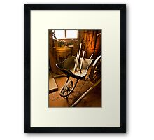 Old style agricultural tools in a wooden shed Framed Print