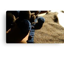 Unraveling a Wool Sweater Canvas Print