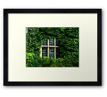 Ivy Engulfs the Manor As Ghostly Images Peak Out  Framed Print