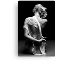 Beautiful woman with white tissue on black background Canvas Print