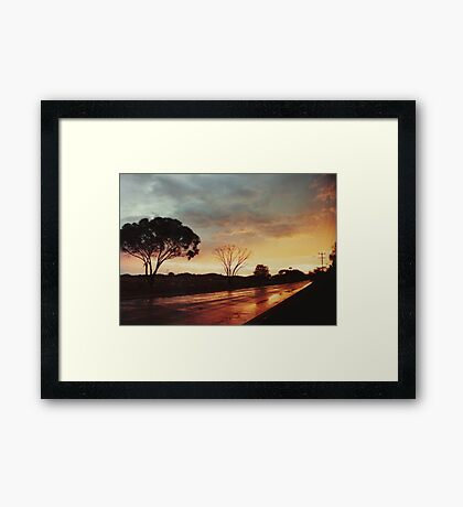 Wet Outback sunset Framed Print