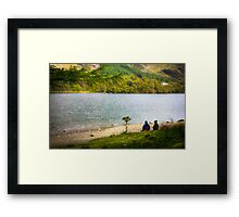 Two walkers share a view of Lake Buttermere, UK Framed Print