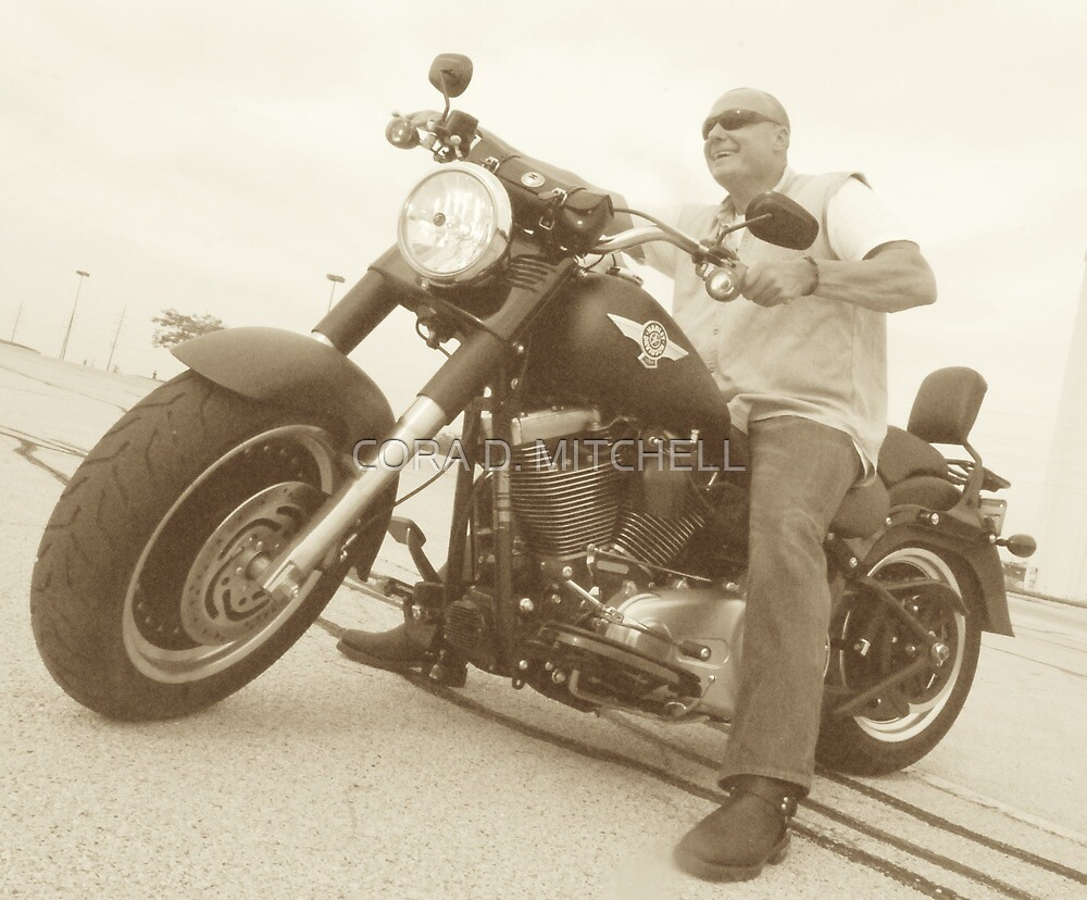 On his Harley by CORA D. MITCHELL