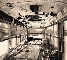 Old Rusty School Bus In Sepia Motion by Bo Insogna