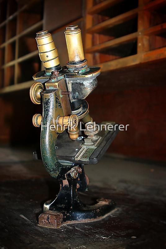 Old Microscope by Henrik Lehnerer