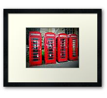 Iconic red telephone boxes Framed Print