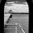 Pier through the window. by Adrian Cusmano