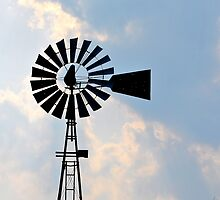 Silhouetted Windmill by wessonp