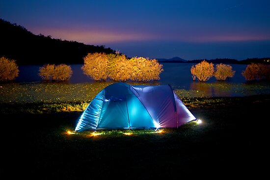 Illuminated tent on dam by kmatm