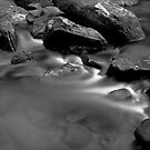 Rocks in a river by tpfeller