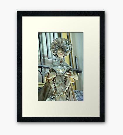Doll in a beautiful dress Framed Print