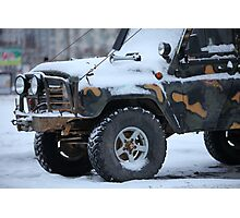 SUV in snow Photographic Print