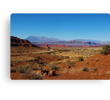 Lonely highway through red rock desert, Utah Canvas Print