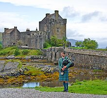 Eilean Donan Castle and the Lone Piper by Chris Thaxter