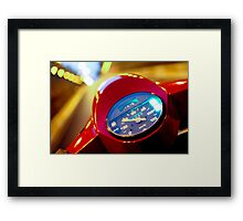 Red Vespa in the traffic Framed Print