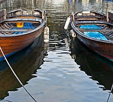 two wooden boats by Joana Kruse