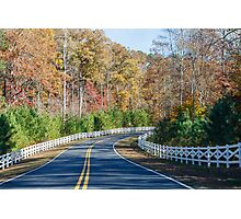 Road Curving Through Autumn Trees and White Fence Photographic Print