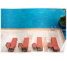 poolside deckchairs alongside blue swimming pool from top view Poster