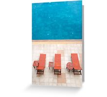 poolside deckchairs alongside blue swimming pool from top view Greeting Card