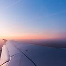 Sunrise from a plane horizontal by LaurentS