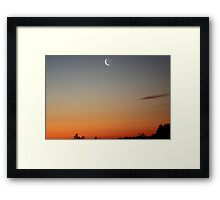 A slither of moon, over the sunset. Framed Print